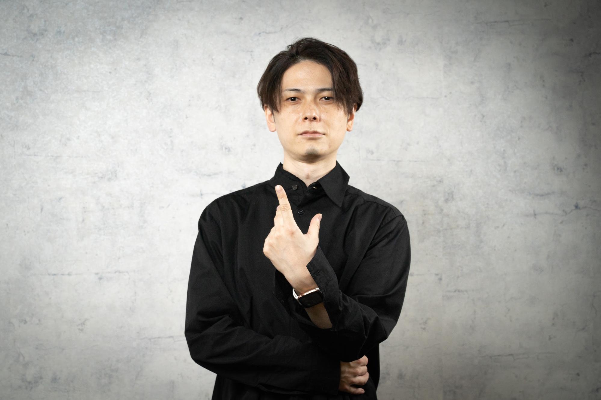 小俣泰明 写真
